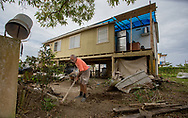 March 24, 2018, Toa Baja Puerto Rico, USA: Antonio Garcia Morales cleaning his brother's house in Toa Baja, a municipality, located in the northern coast of Puerto Rico, 6 months after Hurricane Maria. Toa Baja was one of the hardest hit communities by Hurricane Maria.  Entire neighborhood was submerged during Hurricane Maria.