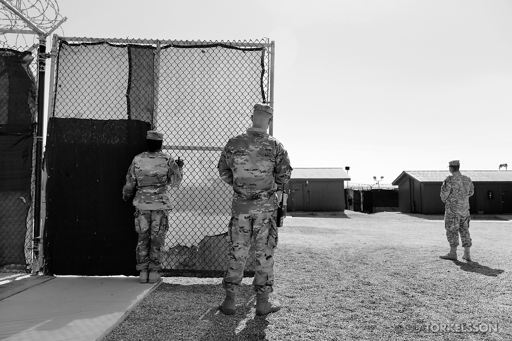 Military guards at the prison camp at Guantanamo, Cuba, Jan 28 2017. The guards turn away their faces so you cannot identify them. It is standard operation procedure when pictures are made. When you work as a journalist at the Guantanamo you work under military censorship and all your material is checked every day and approved for publication.<br /> The prison camp on the Guant&aacute;namo naval base was the creation of President George W. Bush. The prison camp was considered an important part of the US war on terrorism. Over the years, 779 people have been brought to the camp. 41 people are still detained. Of them, 26 people count as &quot;forever prisoners&rdquo;, indefinite detainees under the Law of War. Two prisoners have been in the camp since it was opened in January 2002. The last prisoner taken to the camp came in March 2008. The so-called war on Terror and the Guantanamo prison camp have been heavily criticized for violation of human rights regarding torture and habeas corpus.<br /> It is unclear what US President Donald Trump wants to do with the camp, but during the election campaign he said that he would fill Guant&aacute;namo Bay with &quot;bad dudes&quot;. Photo by Ola Torkelsson<br />