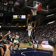 Kayla McBride, Notre Dame, shoots over Moriah Jefferson, Connecticut, during the Connecticut V Notre Dame Final match won by Notre Dame during the Big East Conference, 2013 Women's Basketball Championships at the XL Center, Hartford, Connecticut, USA. 11th March. Photo Tim Clayton