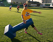 Kirsty Smith of Rochester runs into first base as defenders scramble for the ball behind her during a demonstration of Beep Baseball at Frontier Field in Rochester on Tuesday, June 23, 2015.