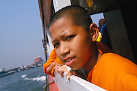 young monk on river ferry in Bangkok, Thailand, 2002