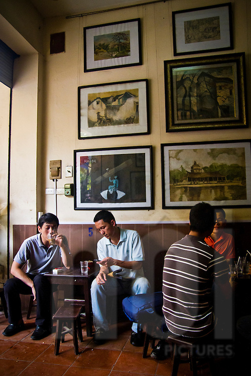 Men drinking coffee at Cafe Lam in Hanoi, Vietnam, Asia