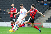 Shrewsbury Town midfielder Gary Deegan (18) battles for possession with Milton Keynes Dons Dons midfielder Darren Potter (8) during the EFL Sky Bet League 1 match between Milton Keynes Dons and Shrewsbury Town at stadium:mk, Milton Keynes, England on 25 February 2017. Photo by Dennis Goodwin.