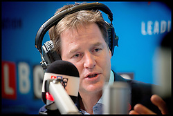 Image ©Licensed to i-Images Picture Agency. 30/10/2014. London, The Deputy Prime Minister Nick Clegg presents his weekly 'Call Clegg' phone-in on LBC, hosted by breakfast presenter Nick Ferrari, live from Global's London studios. . Picture by Andrew Parsons / i-Images