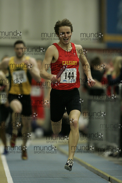 (Windsor, Ontario---13 March 2010) Scott Nicol of University of Calgary Dinos  competes in the men's 4X400 meters at the 2010 Canadian Interuniversity Sport Track and Field Championships at the St. Denis Center. Photograph copyright GEOFF ROBINS/Mundo Sport Images. www.mundosportimages.com