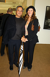 Artist ANISH KAPOOR and his wife SUSANNAH at a private view of the 2004 Frieze Art Fair - a major exhibition attended by most of the leading contempoary art dealers held in Regents Park, London on 14th October 2004.NON EXCLUSIVE - WORLD RIGHTS