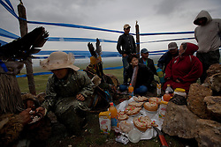 Mongolian Shaman brothers Batgerel (L) and Gankhuyag Batmunkh (2-L) converse with a family of worshippers during a  Shaman ceremony by an 'ovoo' or 'sacred stone' site on Black Mountain Head in Nalaikh district of Ulan Bator in Mongolia, 06 July 2012. The Shaman ceremony is held for a family to give offerings to the spirits of nature and to bring good karma to the members of family. Shamanism comes from the term 'shamans' that refers to priests or mediums that acts as vessels for spirits, gods and demons to communicate with the human world. In Mongolia, they adhere to the ancient beliefs of Tengrism, where spirits live in all of nature, in the sun, moon, lakes, rivers, mountains, and trees.