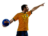 one man with Brazilian jersey throwing soccer ball isolated in white background
