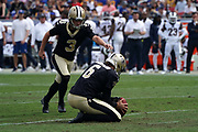 New Orleans Saints kicker Wil Lutz (3) kicks a field goal out of the hold of punter Thomas Morstead (6)l during an NFL football game against the Los Angeles Rams, Sunday, Sept. 15, 2019, in Los Angeles. The Rams defeated the Saints 27-9. (Dylan Stewart/Image of Sport)
