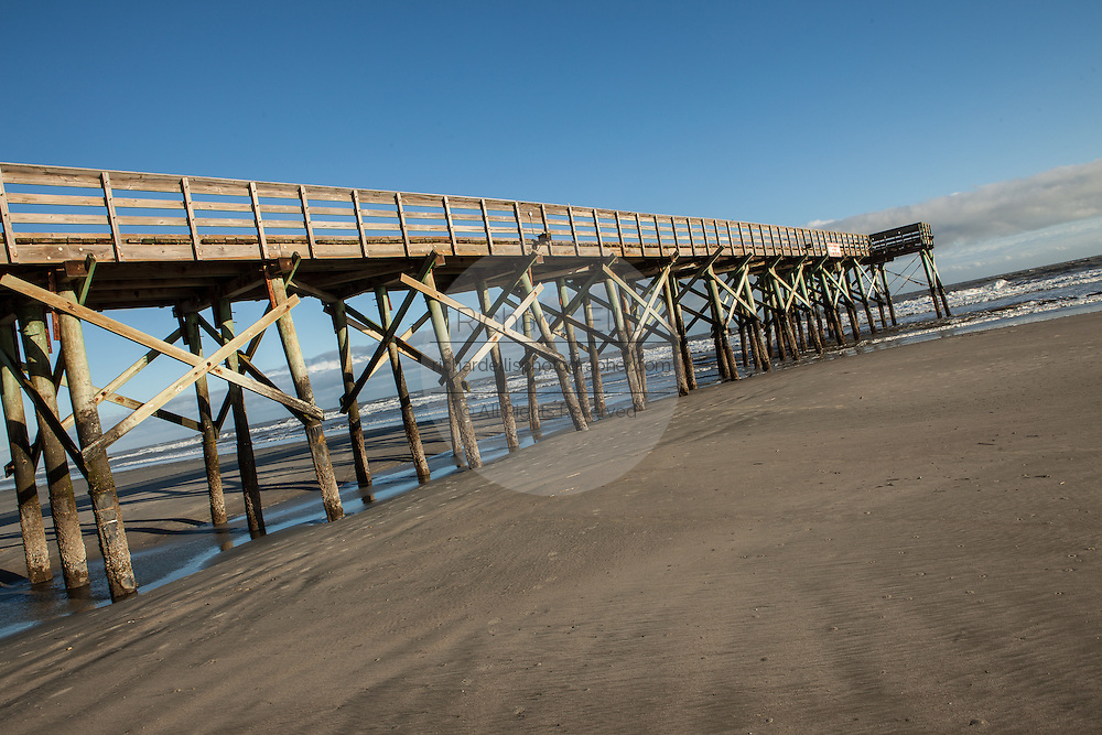Low tide and the pier along front beach on the Isle of Palms, SC.