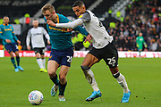 Derby County defender Max Lowe and Hull City forward Jarrod Bowen challenge for the ball during the EFL Sky Bet Championship match between Derby County and Hull City at the Pride Park, Derby, England on 18 January 2020.