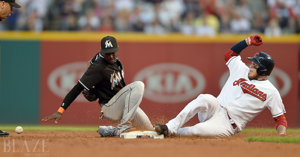 Sep 3, 2016; Cleveland, OH, USA; Cleveland Indians catcher Roberto Perez (55) slides into second with an RBI double as Miami Marlins shortstop Adeiny Hechavarria (3) can't handle the throw during the second inning at Progressive Field. Mandatory Credit: Ken Blaze-USA TODAY Sports