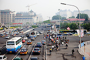 Early morning traffic in the city center of Beijing. Beijing is the capital of the People's Republic of China and one of the most populous cities in the world with a population of 19,612,368 as of 2010.