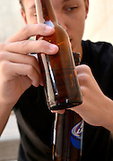 An 18-year-old male with a beer bottle.