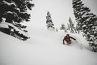 Christopher Smith backcountry skiing on a stormy day in the Twin Lakes area, Wasatch Mountains, Utah.