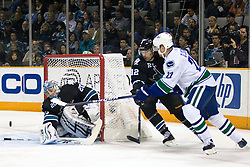 April 8, 2010; San Jose, CA, USA; San Jose Sharks goalie Evgeni Nabokov (20) saves a shot from Vancouver Canucks left wing Daniel Sedin (22) during the first period at HP Pavilion.  San Jose defeated Vancouver 4-2. Mandatory Credit: Jason O. Watson / US PRESSWIRE
