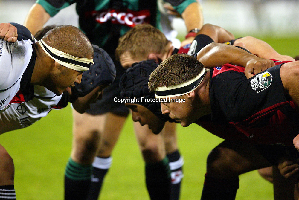 15 May 2004, Rugby Union Super 12 semi final, Crusaders vs Stormers, Jade Stadium, Christchurch, New Zealand.<br />Eddie Andrews (L) and David Hewett pack down in the scrum<br />Crusaders won 27-16 to go through to the final against the Brumbies next week.<br />Please credit: Sandra Teddy/Photosport