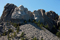 General view Mt. Rushmore with sculptures of former presidents George Washington, Thomas Jefferson, Theodore Roosevelt, and Abraham Lincoln, Mount Rushmore National Monument, South Dakota, United States of America