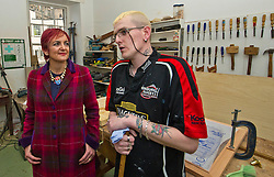 Pictured: Angela Constance met Steven Scott whose confidence has been built up over the time he has visited and worked at the Grassmarket Centre<br /> <br /> Communities Secretary Angela Constance MSP visited the Grassmarket Community Project today to see how a successful social enterprise works. While she was there, Ms Constance launched the Scottish Government's social enterprise strategy.<br /> <br /> Ger Harley | EEm 14 December 2016