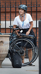 © Licensed to London News Pictures. 09/07/2018. London, UK. Marina Wheeler, wife of Boris Johnson, arrives by bicycle  at the official residence of the foreign secretary after Boris Johnson resigned. Brexit Secretary David Davis has resigned over Prime Minister Theresa May's Brexit Plan. Mr Davis was appointed to the post in 2016 and was responsible for negotiating the UK's EU withdrawal. Photo credit: Peter Macdiarmid/LNP