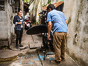 27 AUGUST 2016 - BANGKOK, THAILAND: A Thai TV crew does a report from the Pom Mahakan slum in Bangkok. The Pom Mahakan community is known for fireworks, fighting cocks and bird cages. Mahakan Fort was built in 1783 during the reign of Siamese King Rama I. It was one of 14 fortresses designed to protect Bangkok from foreign invaders. Only two of the forts are still standing, the others have been torn down. A community developed in the fort when people started building houses and moving into it during the reign of King Rama V (1868-1910). The land was expropriated by Bangkok city government in 1992, but the people living in the fort refused to move. In 2004 courts ruled against the residents and said the city could evict them. The city vowed to start the evictions on Sept 3, 2016, but this week Thai Prime Minister Gen. Prayuth Chan-O-Cha, sided with the residents of the fort and said they should be allowed to stay. Residents are hopeful that the city will accede to the wishes of the Prime Minister and let them stay.       PHOTO BY JACK KURTZ