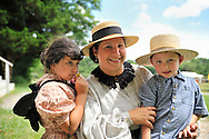 MICHELE WALKER of Coram, her daughter MADELYN WALKER, 7, and son ROBERT WALKER, 4, wear clothes of American Civil War era while portraying family members of Union soldiers at Camp Scott re-creation, at Old Bethpage Village Restoration, to commemorate 150th Anniversary of American Civil War, on Saturday, July 21, 2012, in Old Bethpage, New York, USA.