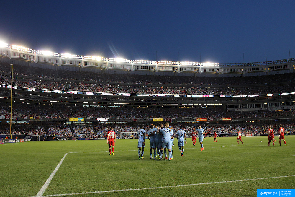 Manchester City players celebrate a goal from Stevan Jovetic during the Manchester City Vs Liverpool FC Guinness International Champions Cup match at Yankee Stadium, The Bronx, New York, USA. 30th July 2014. Photo Tim Clayton