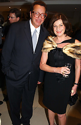LORD & LADY SAATCHI at the Conservative party Pre-Conference Season party hosted by Lord Saatchi and Lord Strathclyde and held at M&C Saatchi, 36 Golden Square, London W1 on 7th September 2004.