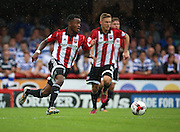 Josh Clarke (Brentford midfielder) with a Brentford counter attack during the Sky Bet Championship match between Brentford and Reading at Griffin Park, London, England on 29 August 2015. Photo by Matthew Redman.