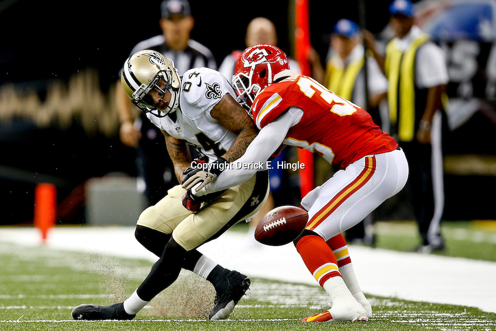 Aug 9, 2013; New Orleans, LA, USA; New Orleans Saints wide receiver Kenny Stills (84) has a pass broken up by Kansas City Chiefs defensive back Neiko Thorpe (38) during the second quarter of a preseason game at the Mercedes-Benz Superdome. Mandatory Credit: Derick E. Hingle-USA TODAY Sports