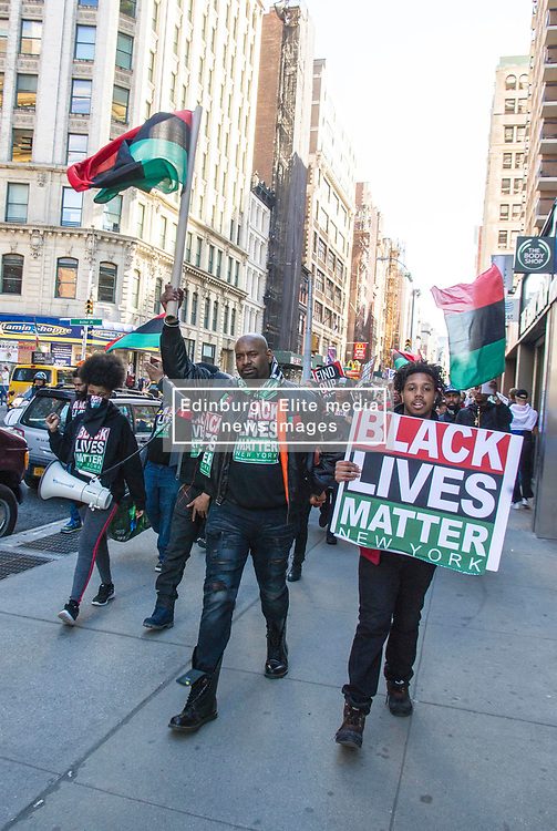 Pictured: <br /> Sunday saw the Black Lives Matter movement lead a protest march starting at the Battery and headed up Broadway in New York which revived the Black Violence, White Silence chant of the 60s. Around 150 protesters were accompanied by around 20 NYPD officers, some on motor cycles, to ensure nothing untoward happened on a very hot New York Sunday<br /> <br /> <br /> Ger Harley | EEm 9 April; 2017