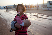 Syrian refugee girl Zanab Hilaau from Daara,Syria holds her baby sister Rokya Al-Zaatri refugee camp in the Jordanian city of Mafraq, near the border with Syria, February 10, 2013.  ..Jordan  recently announced  that the number of Syrian refugees in the country is expected to exceed 700, 000 in 2013, the state-run Petra news agency reported. (Photo by Heidi Levine/Sipa Press).