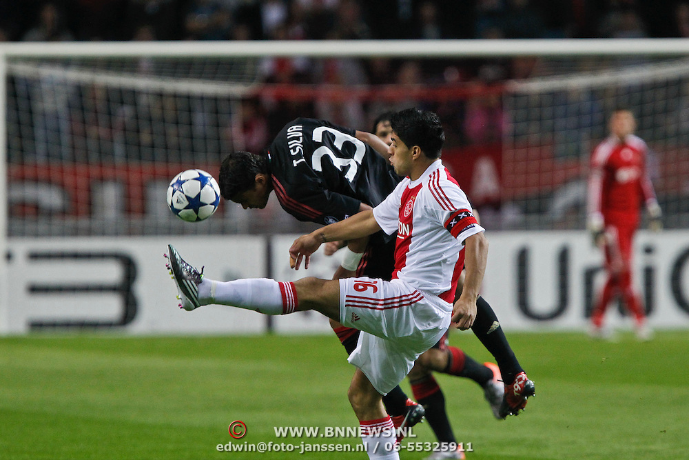 NLD/Amsterdam/20100928 - Champions Leaguewedstrijd Ajax - AC Milan, Luis Suarez in duel met Thiago Silva