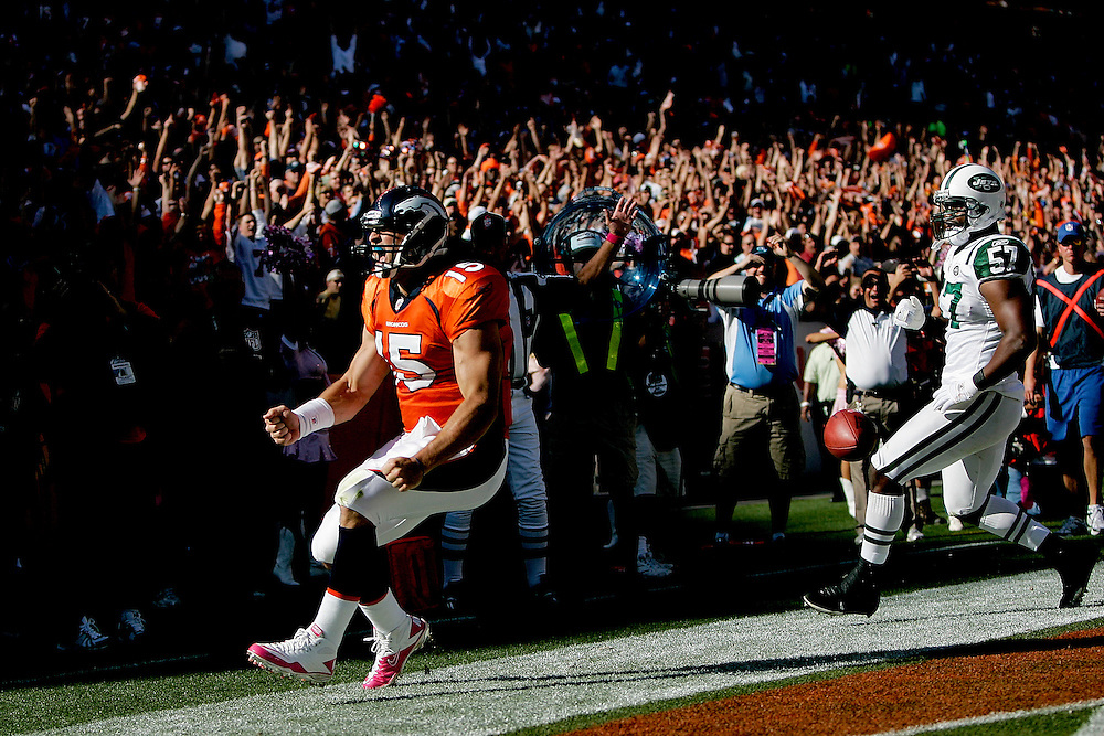 Quarterback Tim Tebow #15 of the Denver Broncos celebrates his touchdown run in the first half against the New York Jets at INVESCO Field at Mile High on October 17, 2010 in Denver, Colorado.