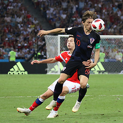 July 7, 2018 - Sochi, Russia - July 07, 2018, Sochi, FIFA World Cup 2018, the playoff round. 1/4 finals of the World Cup. Football match Russia - Croatia at the stadium Fisht. Player of the national team Luka Modric; Daler Kuzyaev. (Credit Image: © Russian Look via ZUMA Wire)