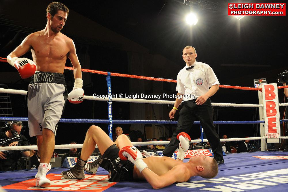 Steve Jennings (black/grey shorts) defeats George Watson at Rainton Meadows Arena, Sunderland, 11th September 2010. Frank Maloney Promotions. © Photo credit: Leigh Dawney