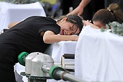Grieving relatives mourn during a funeral service for victims of the Christmas Island asylum seeker boat disaster at the Castlebrook Cemetery in Sydney,Australia. As many as 50 people died when the asylum seeker vessel SIEV 221 crashed on rocks and broke apart off Christmas Island's Rocky Point.