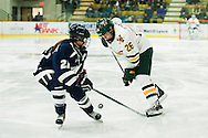 Vermont's Eve-Audrey Picard (26) battles for the puck with New Hampshire's Marie-Jo Pelletier (21) during the women's hockey game between the New Hampshire Wildcats and the Vermont Catamounts at Gutterson Field House on Friday night February 3, 2017 in Burlington. (BRIAN JENKINS/for the FREE PRESS)