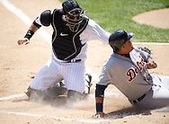 CHICAGO - MAY 15: A.J. Pierzynski #12 of the Chicago White Sox tags out Miguel Cabrera #24 of the Detroit Tigers at home plate on May 15, 2012 at U.S. Cellular Field in Chicago, Illinois.  The Tigers defeated the White Sox 10-8.  (Photo by Ron Vesely)   Subject:   A.J. Pierzynski; Miguel Cabrera