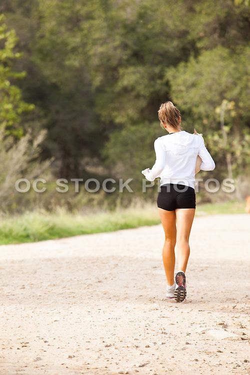 Girl Running on Trail