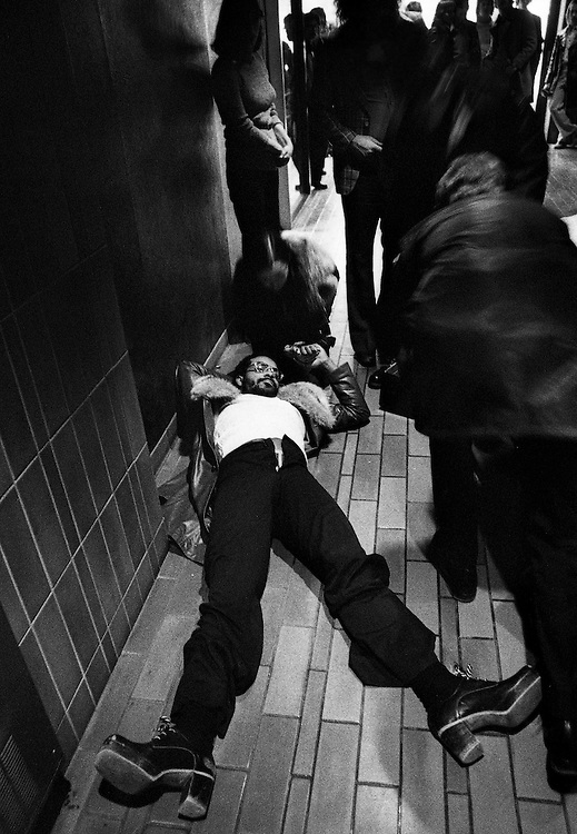 Man is tended to outside a downtown nightclub after being shot during a dispute over drugs in Toronto, Ont. (1975)