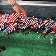 Flags are placed at the foot of Bonnell's casket.Des Moines, Ia., April 25, 2009 - DRAKE RELAYS PHOTOGRAPH BY DAVID PETERSON -