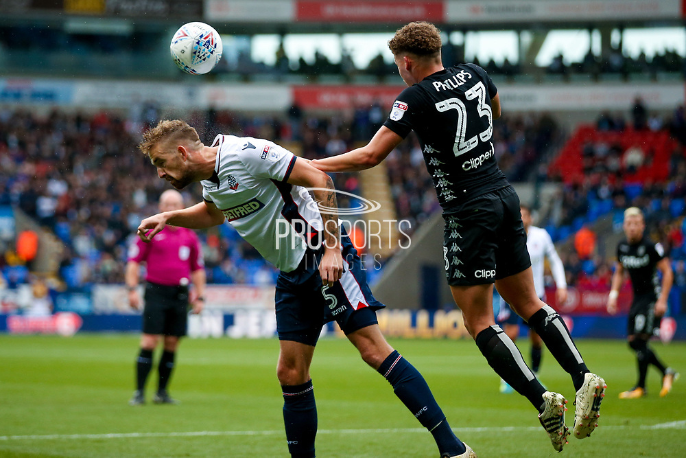 Bolton Wanderers defender Mark Beevers (5) flicks the ball on during the EFL Sky Bet Championship match between Bolton Wanderers and Leeds United at the Macron Stadium, Bolton, England on 6 August 2017. Photo by Simon Davies.