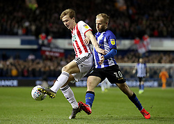 Sheffield United's Kieran Dowell in action with Sheffield Wednesday's Barry Bannan