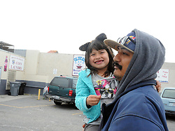 Michael Barron carries young Jenifer Garcia, 5, towards the warming shelter at 20 W. Market St. in Salinas.