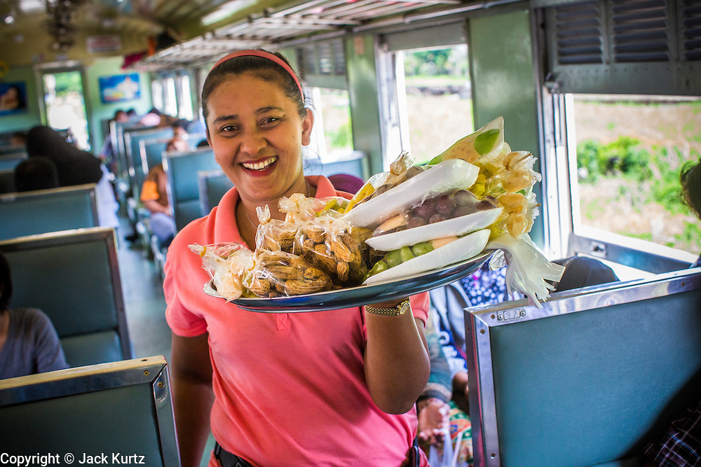 27 OCTOBER 2012 - SUNGAI KOLOK, NARATHIWAT, THAILAND:    A snack vendor on a northbound train from Sungai Kolok, province of Narathiwat, Thailand.  Sungai Kolok has been a center of extremist violence. Several car bombs have been detonated in the city, which is on the Malaysian border and very popular with Malaysian tourists. More than 5,000 people have been killed and over 9,000 hurt in more than 11,000 incidents, or about 3.5 a day, in Thailand's three southernmost provinces and four districts of Songkhla since the insurgent violence erupted in January 2004, according to Deep South Watch, an independent research organization that monitors violence in Thailand's deep south region that borders Malaysia.   PHOTO BY JACK KURTZ