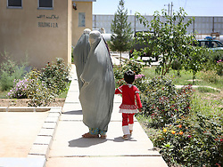 © Licensed to London News Pictures. 15/06/2012. Helmand. Young Afghan women arrive at the Afghan National Police Head Quarters in Lashkar Gah where they hope to receive training and learn basic literacy skills. One day they hope to graduate and gain some element of independence. Army women 'engagement officers' working in Afghanistan. Trained in Pashto, the Afghan language, they accompany infantry on patrols and build relationships with Afghan women in some of the most dangerous parts of Helmand. Photo credit : Alison Baskerville/LNP
