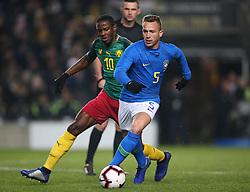 Brazil's Arthur (right) and Cameron's Arnaud Djoum battle for the ball