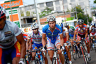 Athletes compete in stage seven of the annual Vuelta al Tachira cycling race in El Vigia, Venezuela on Friday, Jan. 11, 2008. Local and international teams will ride over 1580 kilometers and climb a 1500 meter altitude differential throughout the competition. The grueling, 13-stage race through the Andes mountains is hailed as the premier cycling event in South America.