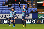 Wycombe Wanderers defender Jason McCarthy celebrate after Aristote Nsiala score an own goal during the EFL Sky Bet League 1 match between Bolton Wanderers and Wycombe Wanderers at the University of  Bolton Stadium, Bolton, England on 15 February 2020.
